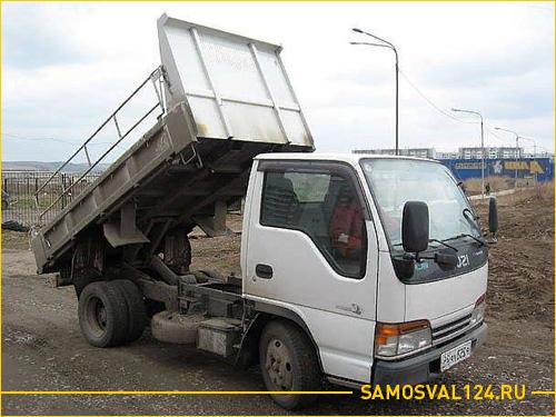 Белый грузовик самосвал Исузу Эльф для перевозки грузов