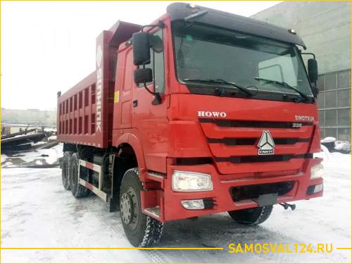 Большой красный грузовик самосвал Shaanxi HOWO